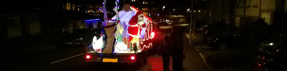 Santa on his mobile sleigh distributing sweets and good cheer in Folkestone
