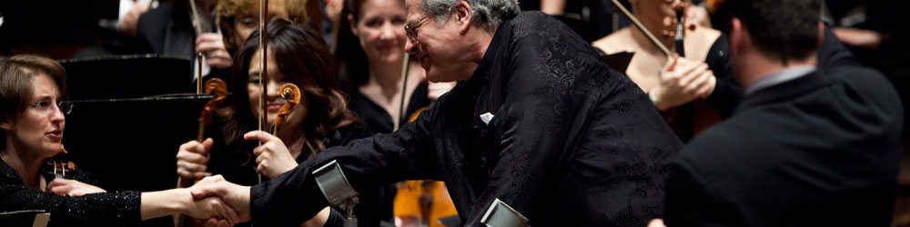 New York Philharmonic violinist and concertmaster Sheryl Staples congratulates violin virtuoso Itzhak Perlman on a beautiful performance. Perlman joined with the New York Philharmonic in the Concert to End Polio, an effort to raise awareness and funds for polio eradication, at Avery Fisher Hall at the Lincoln Center for the Performing Arts in New York City on 2 December 2009.